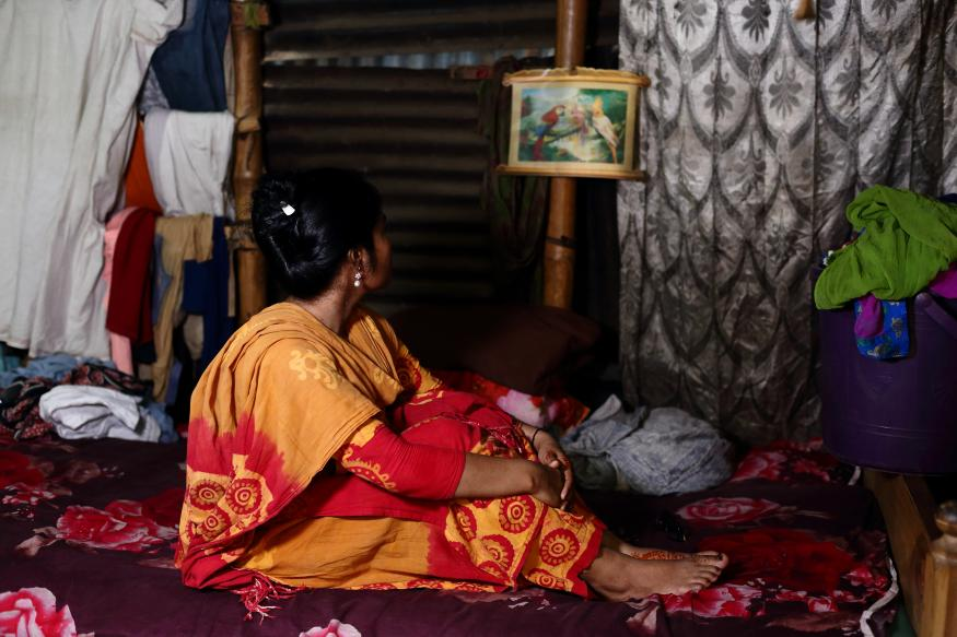 Nurjan, 26, sitting in her room Fabeha Monir/ActionAid