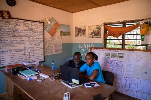 Florence Mramba at the office with Peter Komora