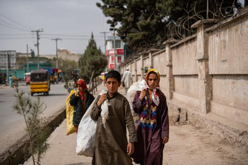 Nematullah, along with his friends, walks the streets of Herat picking litter.