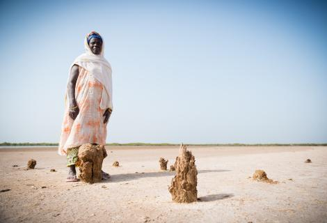 A photo of a woman in a drought area