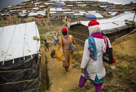 Women walk down a hill to the densely populated Mainnerghona refugee camp, Cox's Bazar