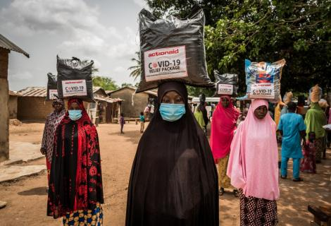 Women wearing face masks receive food support from ActionAid in Nigeria