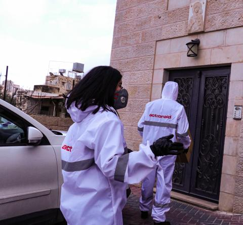 AAP's staff members and youth volunteers distributing medical protective equipment and hygiene products to 300 Palestinian families in home quarantine.