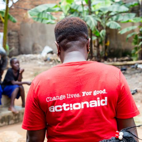 A person wearing an ActionAid t-shirt