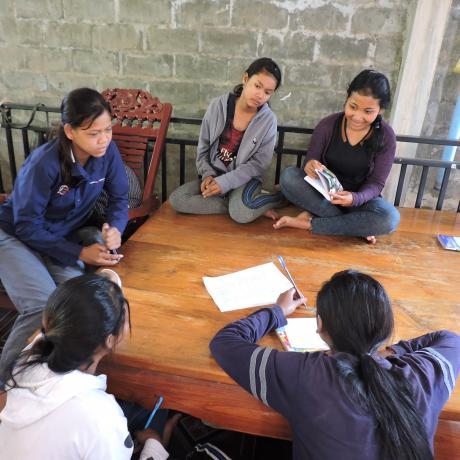 Young women taking part in a research exercise in Cambodia