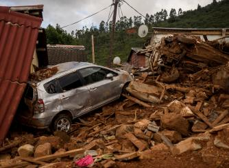 A car and house destroyed by rubble after Cyclone Idai