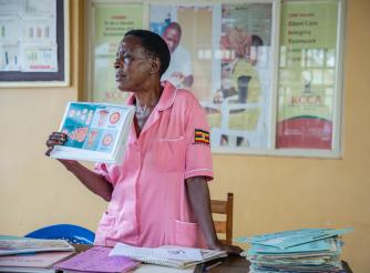 Nurse Margaret Kasolo, 57, educates women at Kawala Health Center IV in Kampala, Uganda