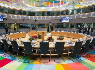 Inside the EU Council, roundtable with chairs and a multicoloured carpet