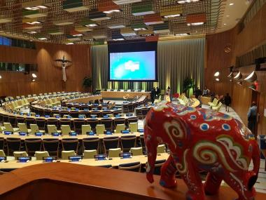 A model elephant in a large meeting hall
