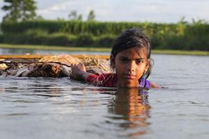 A girl wading through high water