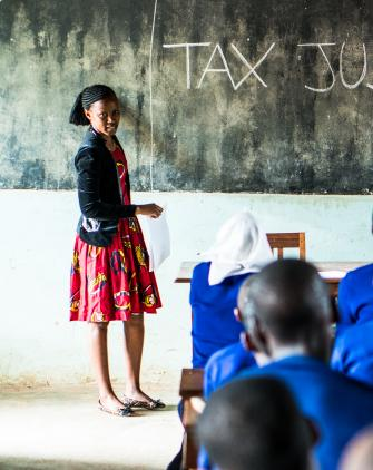 Hearing-impaired girls learning about education funding through tax justice in Tanzania.